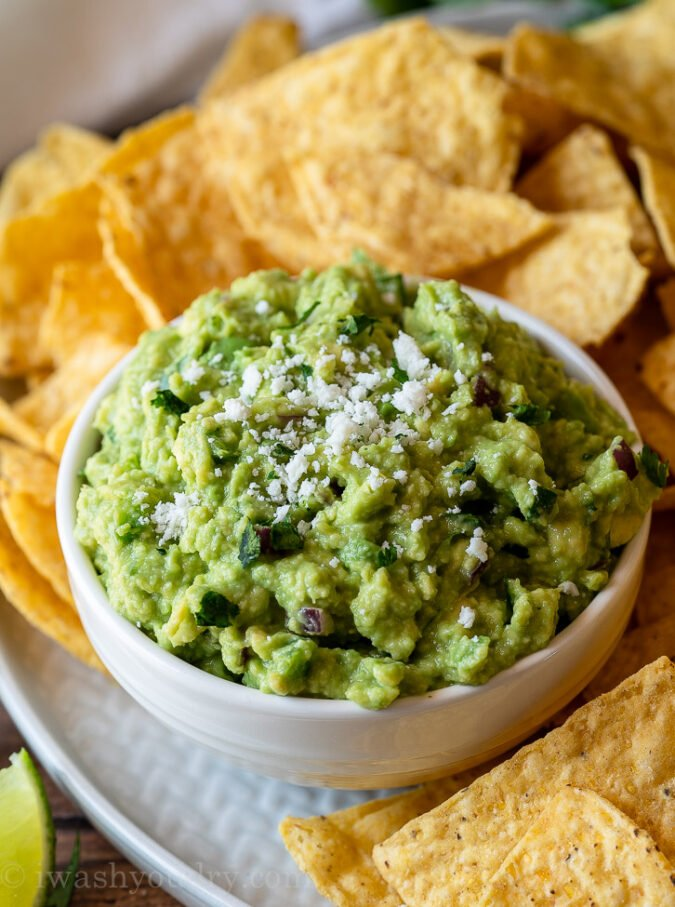 Top your Authentic Guacamole Recipe with fresh cotija cheese and serve with tortilla chips!