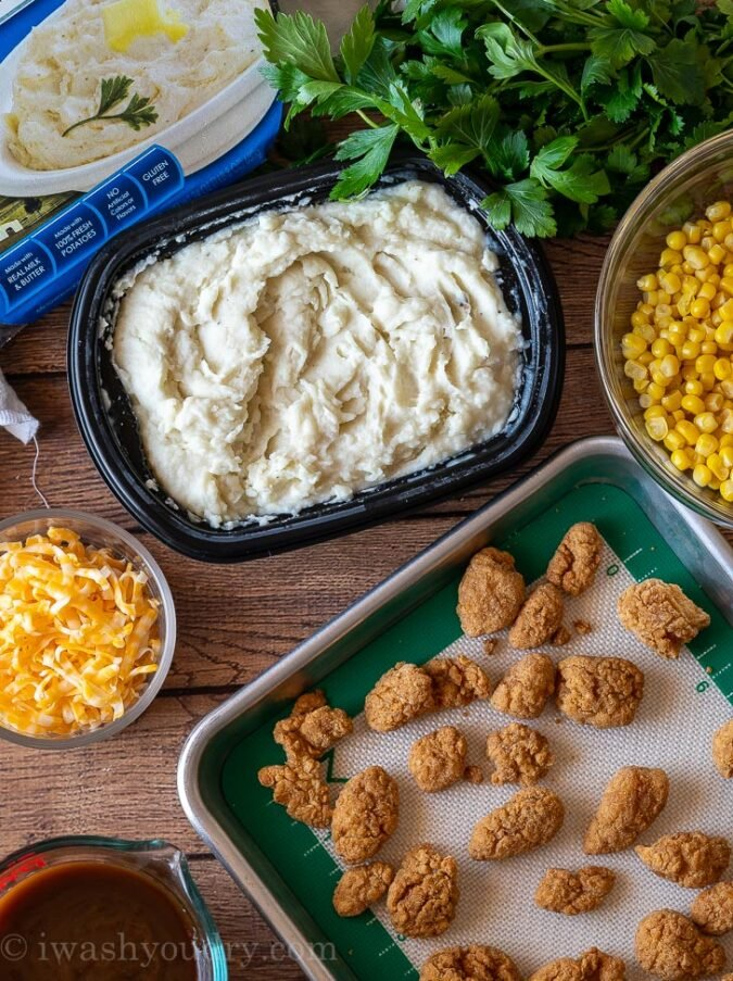 Combine the mashed potatoes, cheese, corn, crispy chicken and gravy in a bowl and dinner is served!