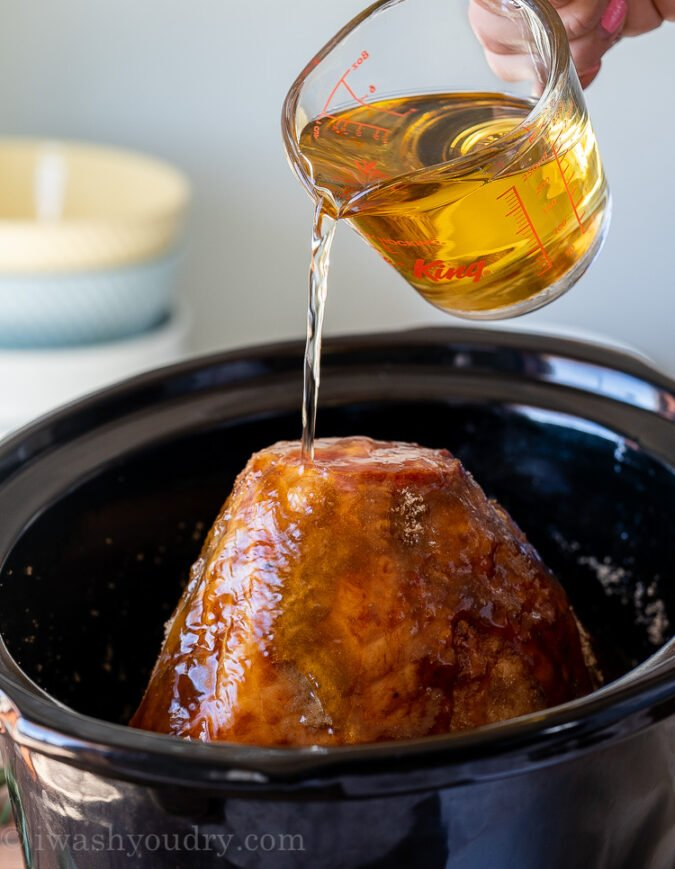 Pour apple cider over the top of the ham and cook in the crock pot.