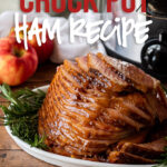 This super easy Crock Pot Ham Recipe is glazed with honey, brown sugar and apple cider then slow cooked to juicy perfection.