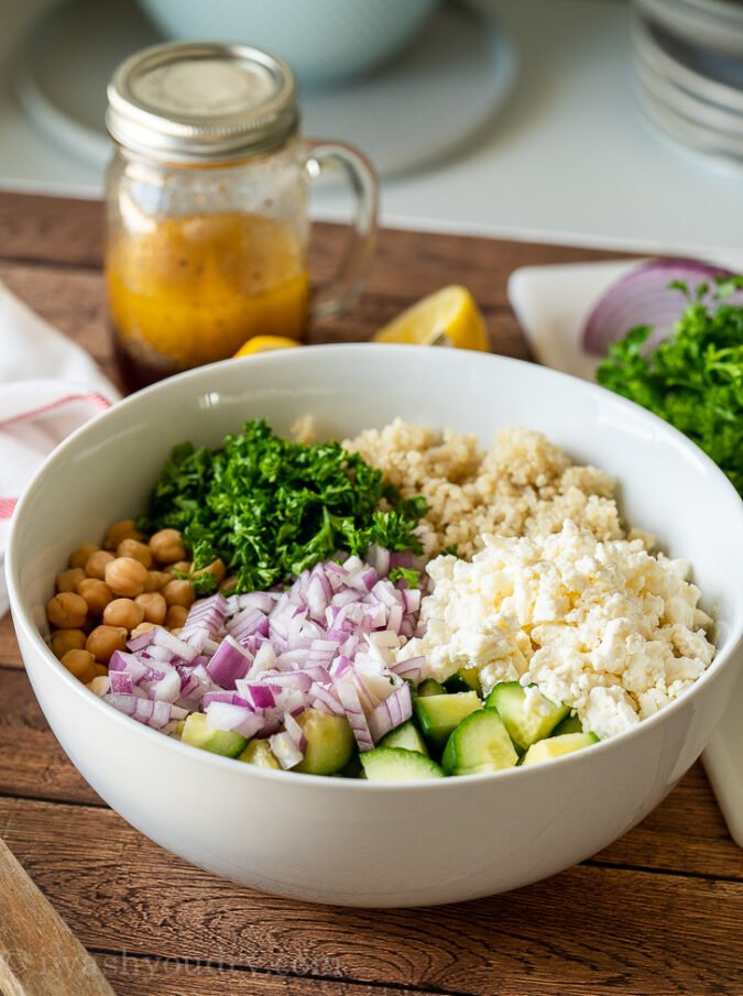 Combine all the ingredients for this cool and refreshing quinoa salad in a large bowl.