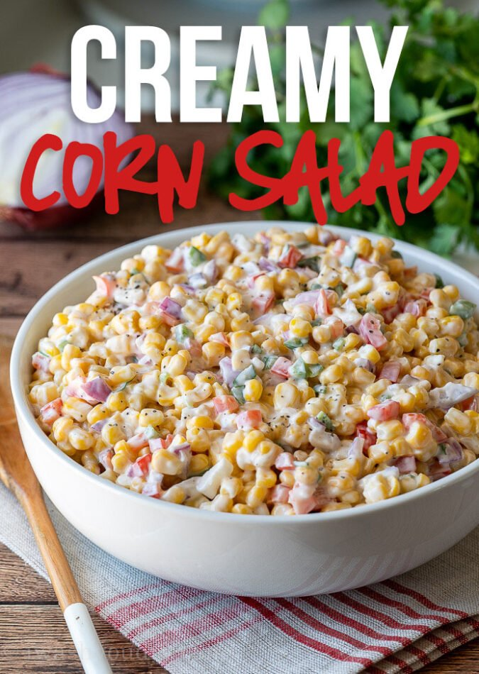 This Creamy Corn Salad Recipe is a quick and easy side dish that's filled with crisp corn kernels that pop in a creamy sauce; perfect for summer potlucks and bbq's!