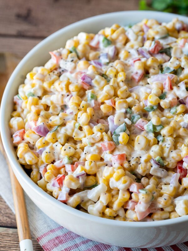 Serve this creamy corn salad at all your summer pot lucks and bbq's and watch it disappear so fast!