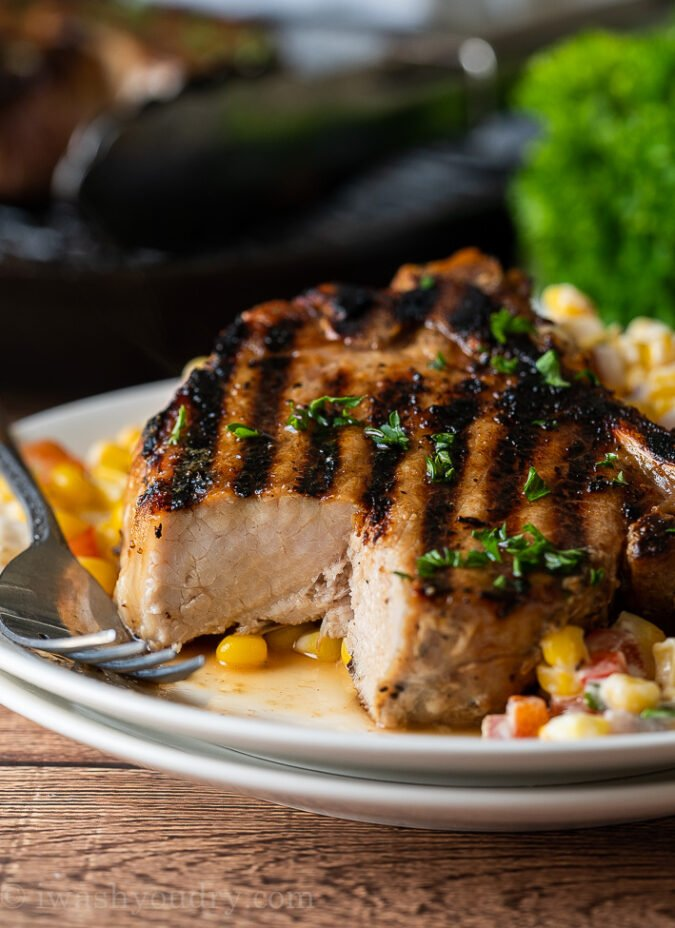 Tender and juicy grilled pork chops are a super quick and easy recipe for bbq's and cookouts!