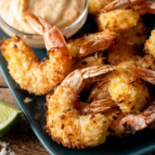 A tray of food, with coconut Shrimp
