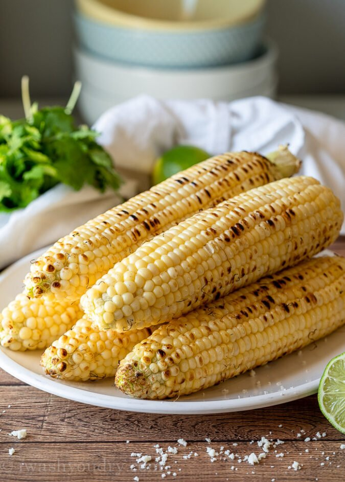 Grill the corn over high heat to slightly char it and then cut off the kernels into a bowl.