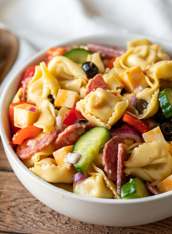 This tortellini recipe is filled with loads of delicious pasta salad goodies and tossed in a zippy dressing! Perfect for summer potlucks and parties!