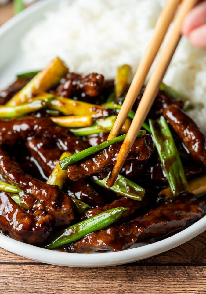 YUM! This super quick and easy Mongolian Beef Recipe is saucy and delicious!