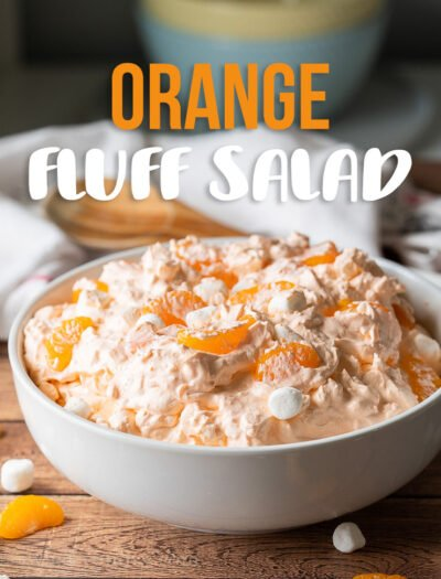 This cool and creamy Orange Fluff Salad Recipe is made with jello, whipped topping, mandarin oranges and a surprise ingredient that you wouldn't expect!