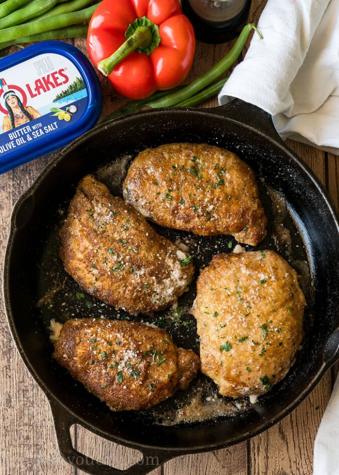 Sear the pork chops in a cast iron skillet before baking them in the oven.