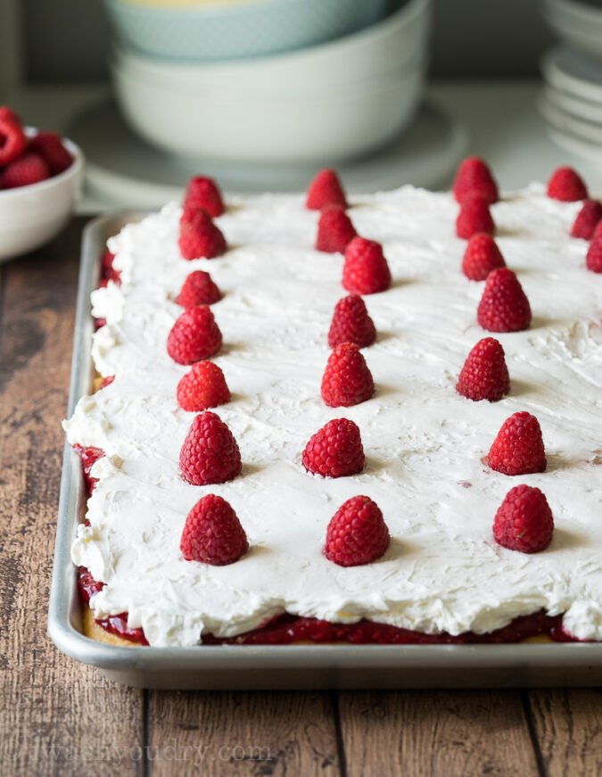 Top this Vanilla Raspberry Sheet Cake with fresh raspberries for a pretty presentation!