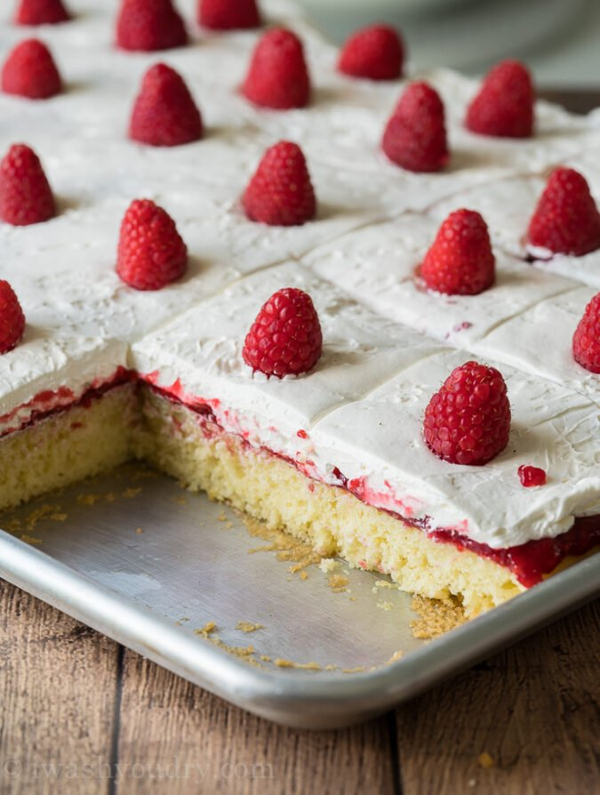 Moist and delicious Vanilla Cake recipe topped with raspberry cake filling and a fluffy cream cheese topping!