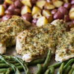 A whole dinner made in just ONE SHEET PAN! This Spinach Herb Baked Chicken Breast Recipe is combined with tender seasoned potatoes and fresh green beans. My whole family loved this one!