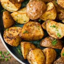 A tray of food, with roasted Potatoes