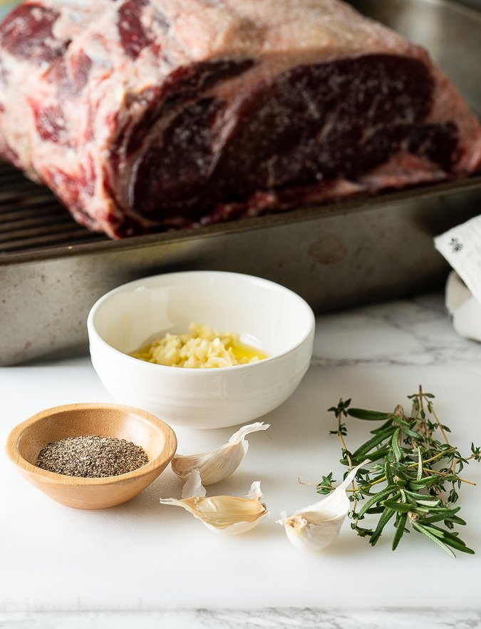 Make a garlic and herb rub to coat the outside of the standing rib roast.