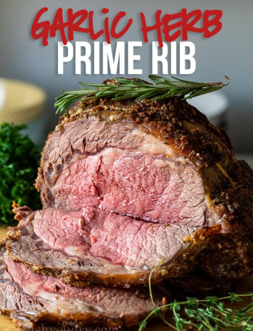 This is the BEST Garlic Herb Prime Rib Recipe! Seasoned with fresh garlic and herbs and roasted to perfection!