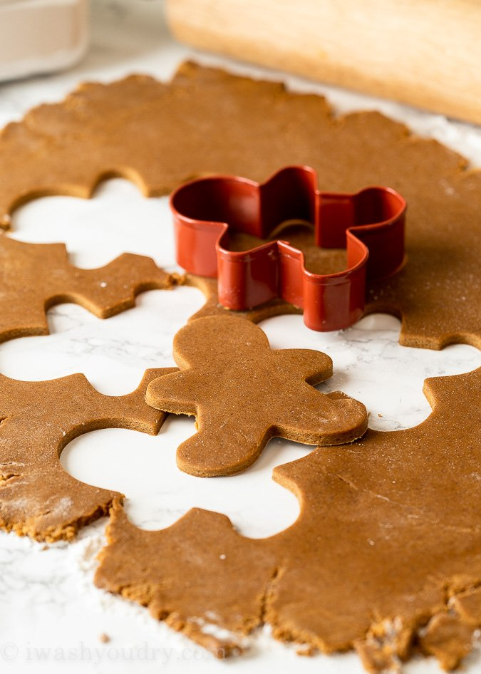 Roll out chilled gingerbread cookie dough and use cookie cutters to cut into shapes.