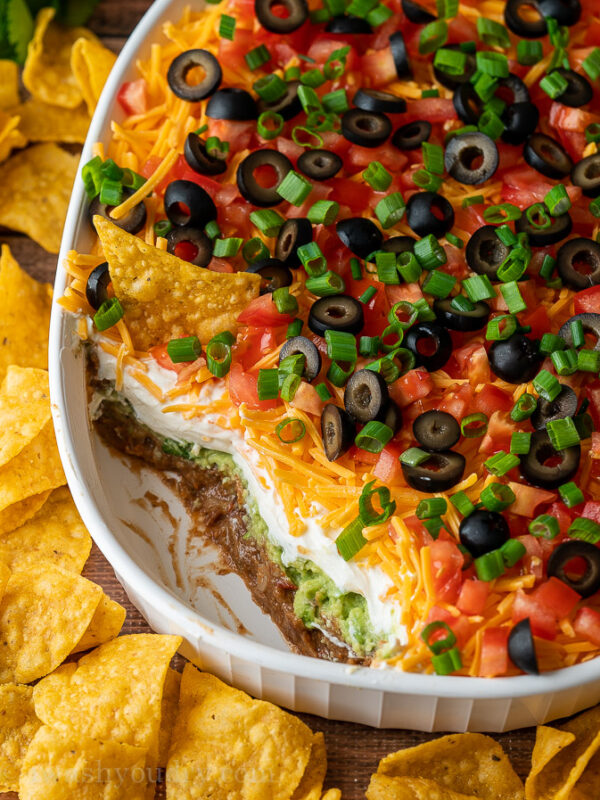 A layered dip on plate of food