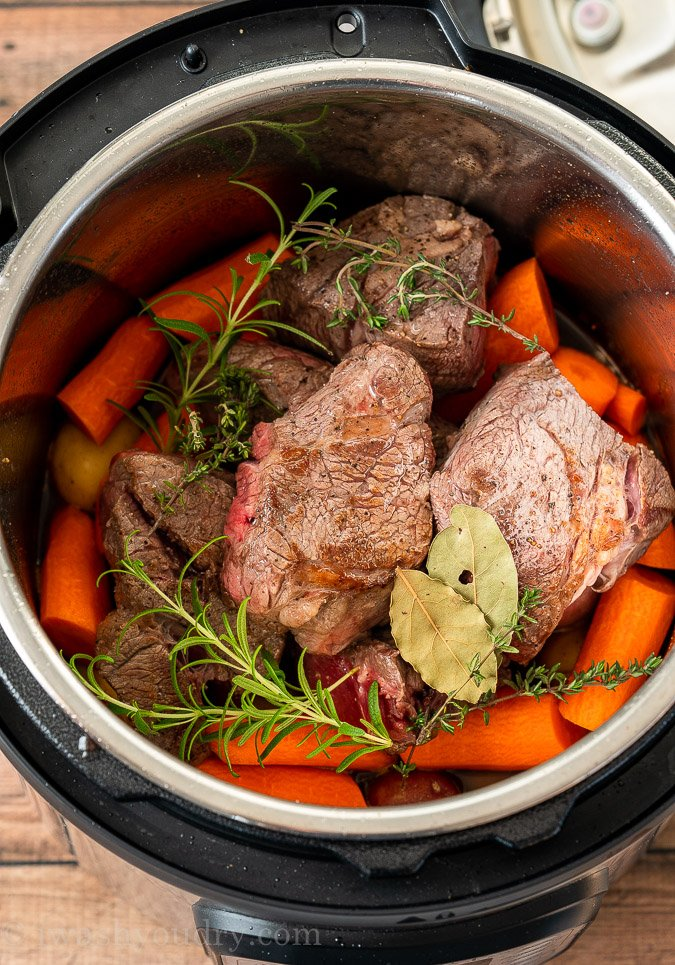 Instant Pot Pot Roast ingredients inside pot before being cooked.