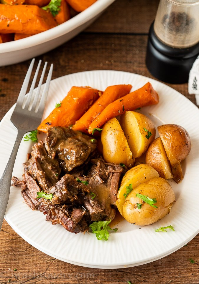 Plated Pot Roast with carrots and potatoes.
