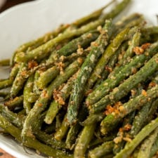 A dish is filled with green beans