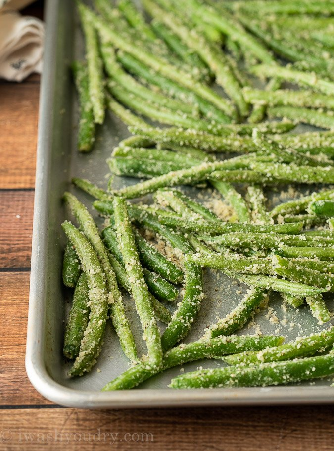 Coat the green beans in parmesan cheese, garlic powder and salt and pepper before roasting