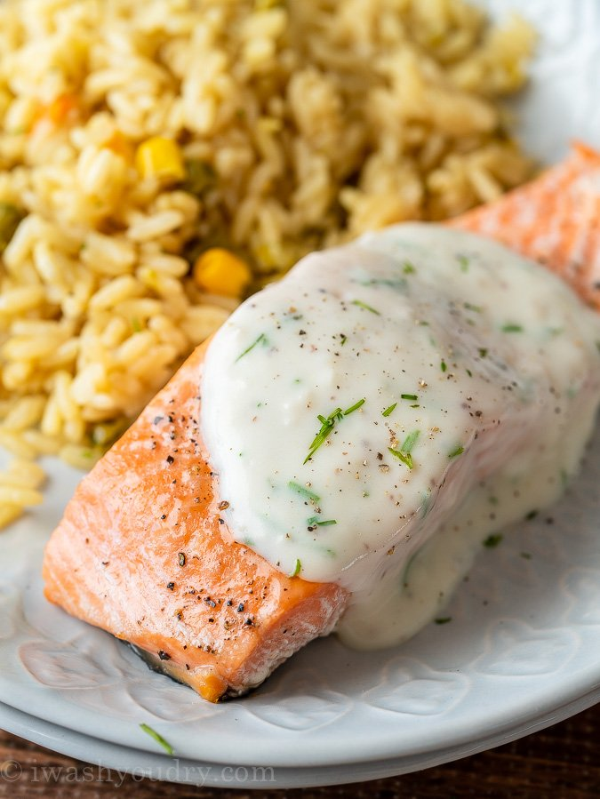 This delightfully easy Baked Salmon Recipe is topped with a creamy dill sauce that'll make you want to lick your plate clean.