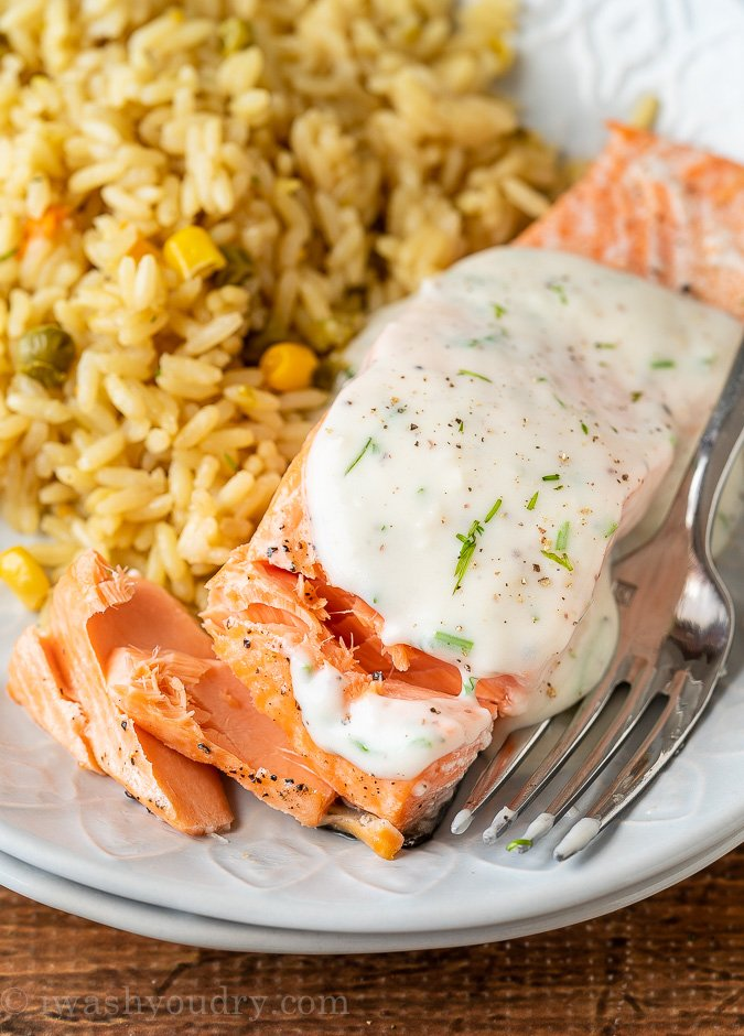 Baked Salmon with a creamy dill sauce served warm over the top.