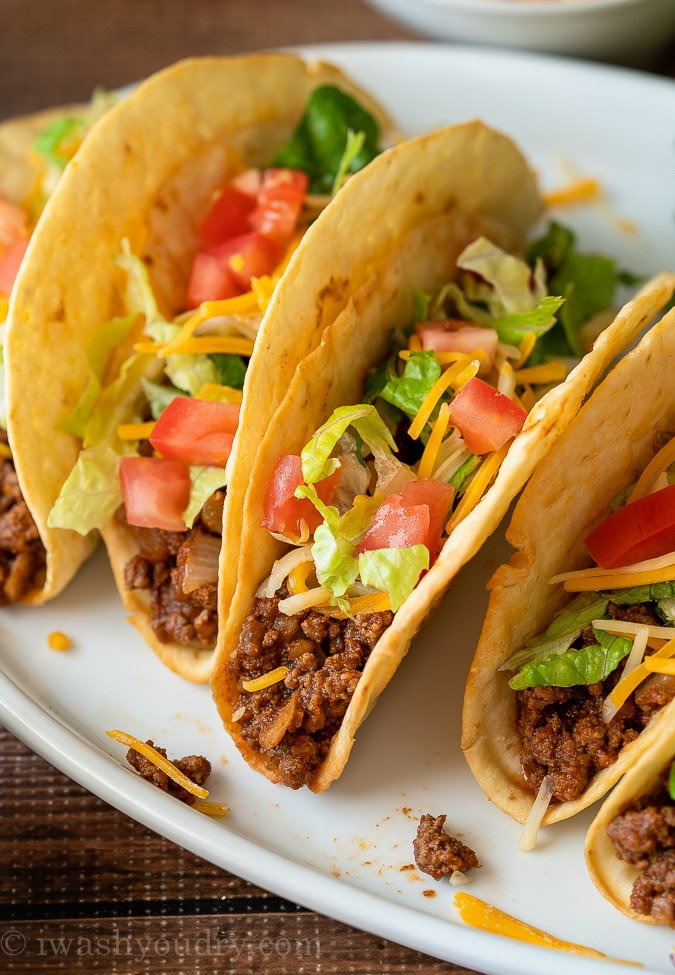 Close up image of Ground Beef Taco with toppings on white plate