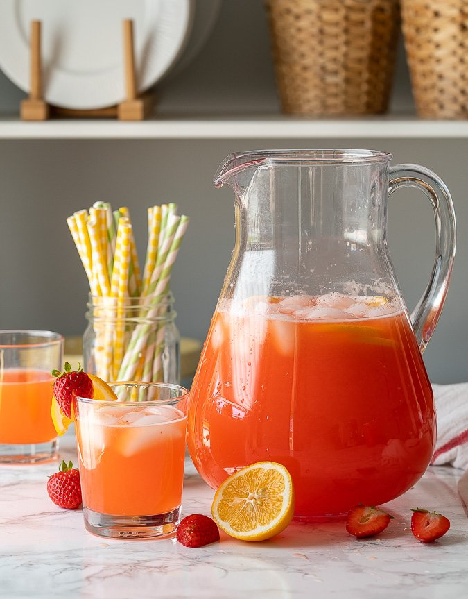 With the weather warming up, it's definitely time to whip up a pitcher of this cool and refreshing Strawberry Lemonade recipe!