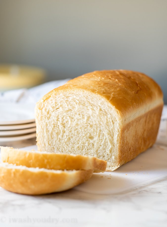 This Easy Homemade Sandwich Bread recipe is perfect for first time bakers! With just basic pantry ingredients you can bake up a soft and fluffy loaf of bread in no time!