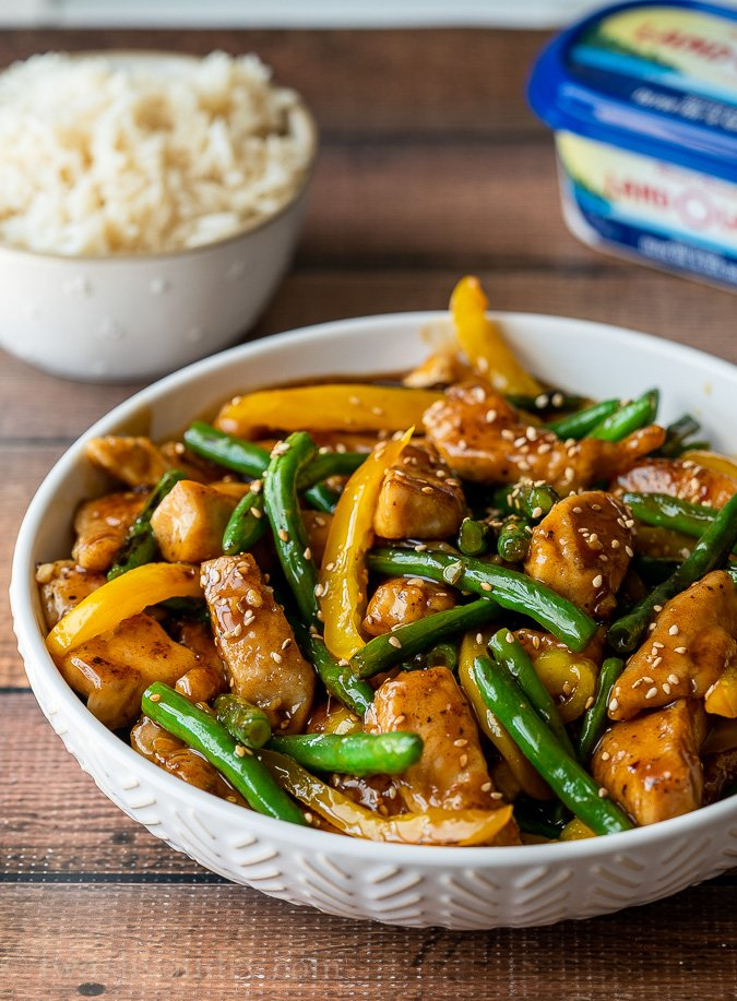 This quick and easy Honey Sesame Chicken Stir Fry is filled with tender chicken breast strips, green beans and yellow peppers in a sweet and sticky sauce.
