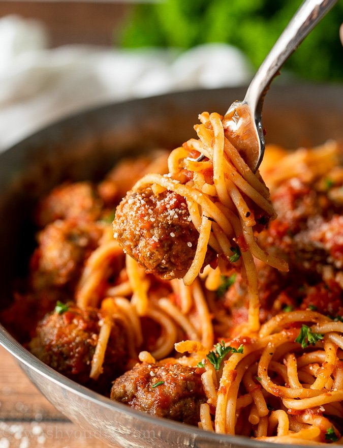 Meatball and spaghetti twirled on fork.