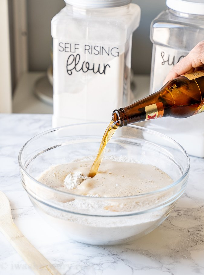 Pour beer into the flour mixture and stir until combined.
