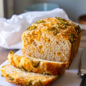This quick (no yeast required) Cheesy Jalapeño Beer Bread Recipe is soft and tender with the perfect blend of cheddar throughout!