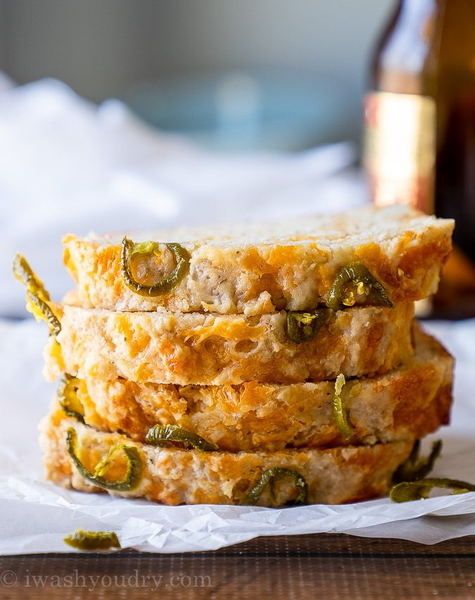 Cheesy Jalapeño Beer Bread sliced and stacked high! Super tender and flavorful bread that's super quick and easy to make!