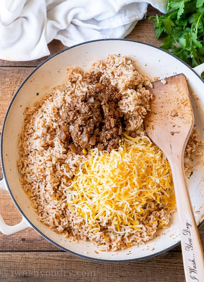 Quick Spanish Rice with cheese and taco meat on top.
