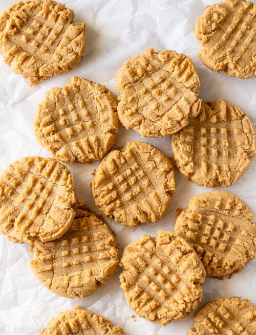 These 5 Ingredient Peanut Butter Cookies are so simple and quick to make. No flour, no chilling, resulting in a chewy, dense inside with a crisp cookie outside.