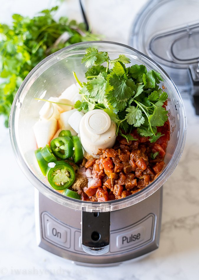 Ingredients needed for restaurant style salsa layered in a food processor