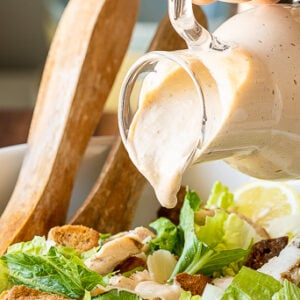 A close up of food on a table, with Caesar Salad