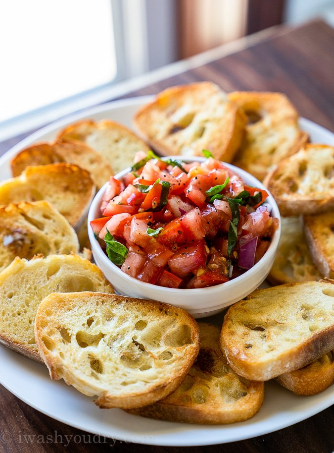 This Easy Bruschetta Recipe is made with fresh tomatoes, basil and onion then served over crisp baguette bread.