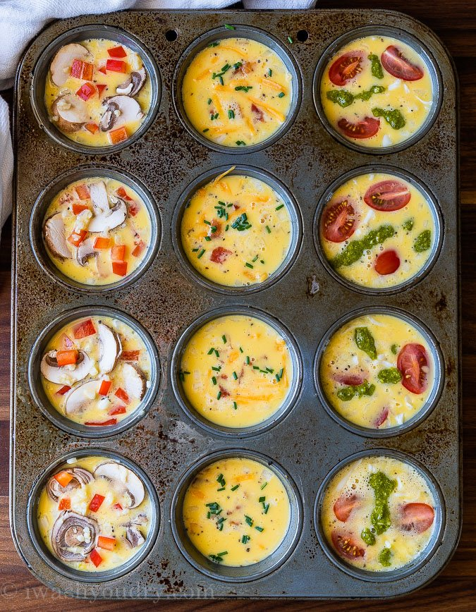 Egg Muffins in a muffin tin with different toppings in each row.