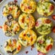 Frittata Egg Muffins 3 different ways on a serving platter.
