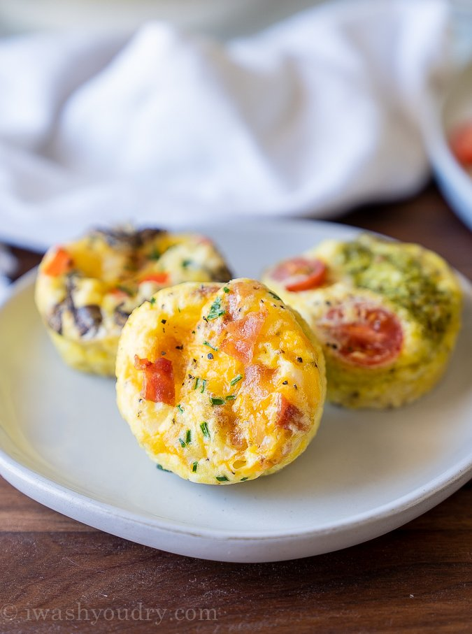 Three types of egg muffins on a white plate.