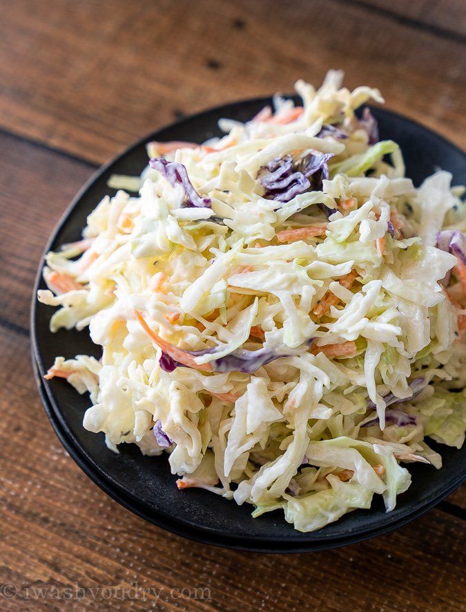 Black plate filled with creamy Coleslaw recipe.