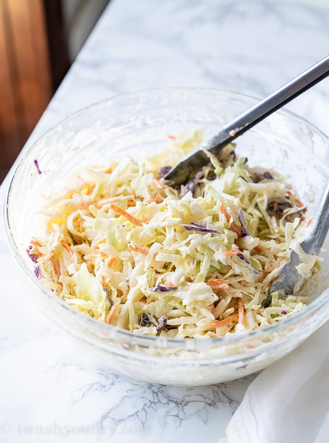 Mix together the coleslaw mix with mayo, apple cider vinegar and sugar in a large bowl.