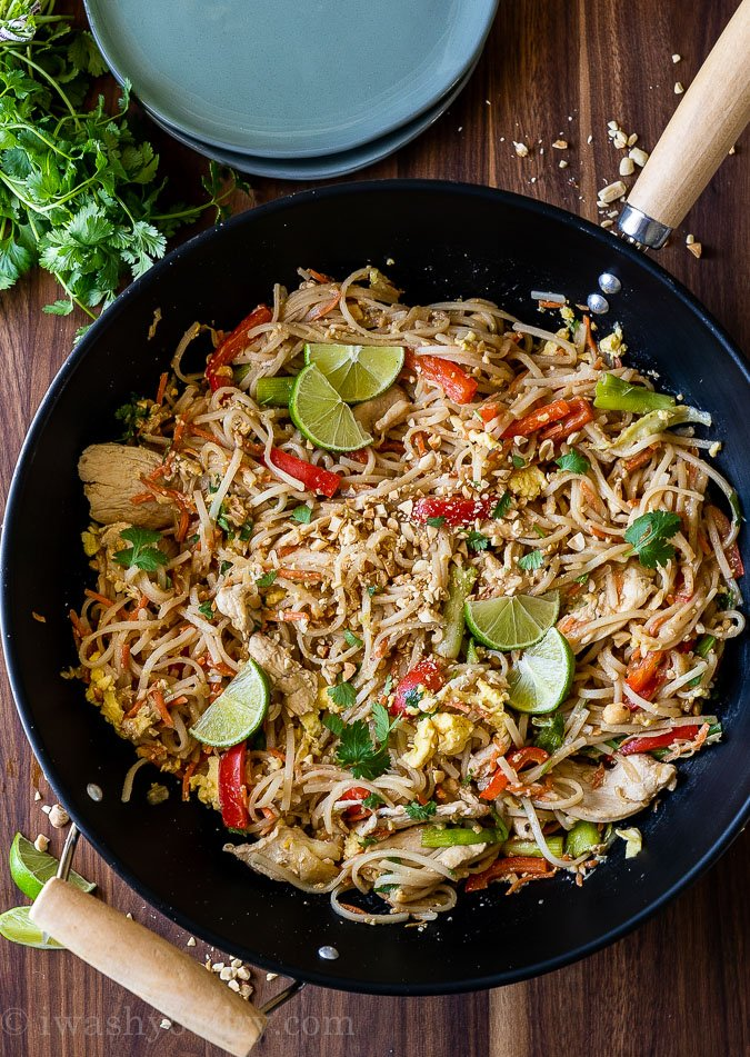 This super easy Chicken Pad Thai Recipe is filled with tender strips of chicken breast, saucy rice noodles and loads of veggies in a quick and easy sauce.