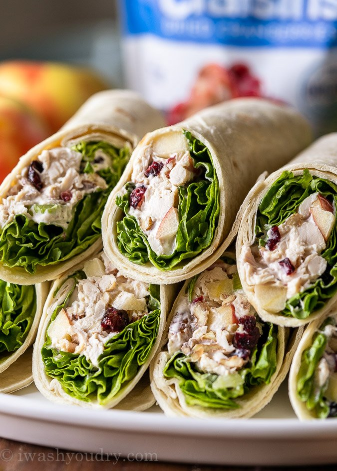 Plate full of sliced Chicken Apple Salad Wraps