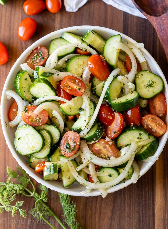Delicious bowl filled with cucumber tomato onion salad