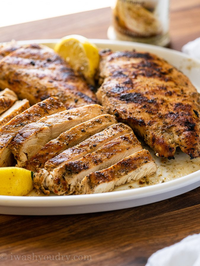 Juicy Grilled Chicken cut into slices on a white plate